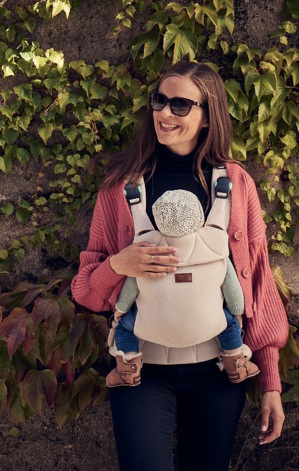 Woman standing with a baby in the Najell Easy Baby Carrier a