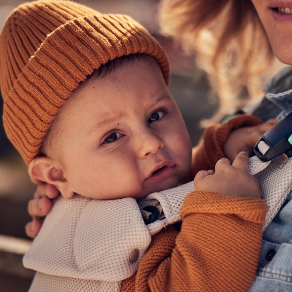 Baby in hat in a Najell Easy Baby Carrier