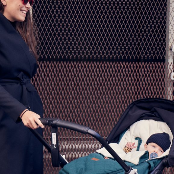 A woman and a baby inside a Najell Footmuff