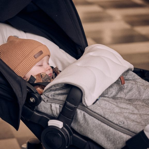 Baby resting in a Najell Footmuff
