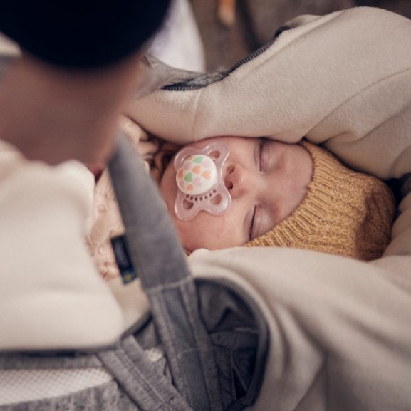 A baby sleeping in a Najell Footmuff