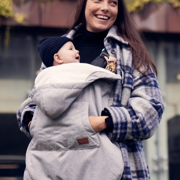 Woman with baby in a Najell All Weather Cover